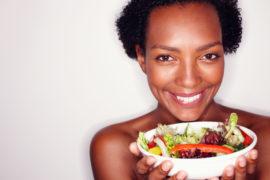 Closeup portrait of woman holding healthy salad